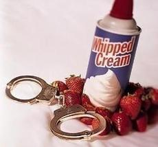 handcuffs and whipped cream